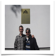 Guy and Yossi infront of the Synagogue Plaque