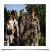Yossi and his cousin at his grandfather's grave