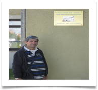 Yossi by the High School Plaque