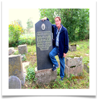 Yossi standing next to his grandfathers grave 2011